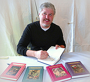 Author photo. Michael Buckley, children's book author, with copies of his Sisters Grimm series. At the Baltimore Book Festival. ©2010