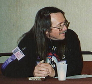 Author photo. Edward Bryant at writers panel, World Fantasy Conference, Seattle, 1989 [credit: Infrogmation of New Orleans]