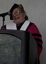 Author photo. Religious studies scholar Wendy Doniger giving the commencement speech at Chicago's Shimer College in 2012. [credit: Miles Stepto / Shimer College]