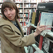 """Forfatter foto. Isobel Harrop places a copy of The Isobel Journal in the Classics section of Waterstones, Warrington. By Foxinthesnow - Own work, CC BY-SA 3.0, <a href=""""https://commons.wikimedia.org/w/index.php?curid=30497773"""" rel=""""nofollow"""" target=""""_top""""></a><a href=""""https://commons.wikimedia.org/w/index.php?curid=30497773"""" rel=""""nofollow"""" target=""""_top"""">https://commons.wikimedia.org/w/index.php?curid=30497773</a>"""