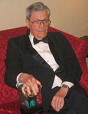 "Author photo. James Edwin Gunn, SF author,<br> at the 2006 Nebula Awards<br> held in New York City, 2007 <br>Copyright © 2007 <a href=""http://ronhogan.tumblr.com"">Ron Hogan</a>"
