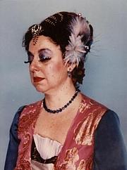 "Författarporträtt. Adrienne Martine-Barnes at Costume Con 3 in 1985 wearing ""Tea Party Gown from Planet Glitzy"""
