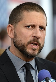 """Photo de l'auteur(-trice). Director David Ayer, gives interviews with the media on the """"Red Carpet"""" during the world premiere of the movie Fury at the Newseum in Washington D.C. (Department of Defense photo by Marvin Lynchard)"""