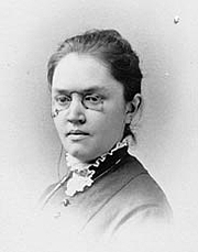 """Autoren-Bild. Photographic portrait of Katharine Lee Bates, author of """"America the Beautiful"""". Image believed to be in Public Domain. By RL - Find a Grave [1], Public Domain, <a href=""""//commons.wikimedia.org/w/index.php?curid=5649414"""" rel=""""nofollow"""" target=""""_top"""">https://commons.wikimedia.org/w/index.php?curid=5649414</a>"""