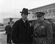Photo de l'auteur(-trice). Lord Halifax, British Ambassador to the United States (left), with an unidentified military officer waiting for the arrival of British Prime Minister Clement Attlee at the National Airport in Washington, D.C., November 10, 1945.