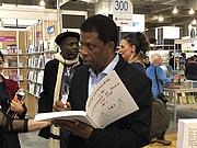 """Författarporträtt. Dany Laferrière au Salon du livre de Montréal 2018 By ActuaLitté - Dany Laferrière, CC BY-SA 2.0, <a href=""""https://commons.wikimedia.org/w/index.php?curid=74757392"""" rel=""""nofollow"""" target=""""_top"""">https://commons.wikimedia.org/w/index.php?curid=74757392</a>"""