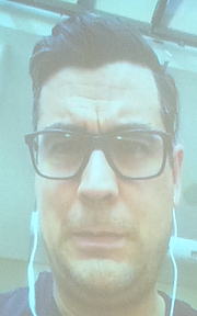 """Author photo. David Robertson photographed in Montréal , Québec, Canada at the Jewish Public Library (thru a projection screen showing a live Skype webcast because he wasn't able to show up there) as part of the 2019 Ya Fest. By Bull-Doser - Own work., Public Domain, <a href=""""https://commons.wikimedia.org/w/index.php?curid=79266265"""" rel=""""nofollow"""" target=""""_top"""">https://commons.wikimedia.org/w/index.php?curid=79266265</a>"""