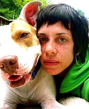 Author photo. Maggie Estep with her pit bull Mickey / Maggie Estep