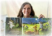 """Författarporträtt. Lisa McCue, author/illustrator, holding """"Quiet Bunny."""" 2009 Baltimore Book Festival. ©2009."""
