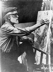 Fotografia de autor. The artist Aldo Carpi, survivor of the Gusen camp, painting in his studio in Milano.