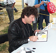 "Author photo. Photo by Jennifer Horn Neil Gaiman autographic a copy of Coraline at the National Book Fair in Washington, in 2005 By Jlahorn at English Wikipedia - Transferred from en.wikipedia to Commons., Public Domain, <a href=""https://commons.wikimedia.org/w/index.php?curid=48197099"" rel=""nofollow"" target=""_top"">https://commons.wikimedia.org/w/index.php?curid=48197099</a>"