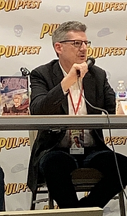 "Author photo. Eckert at Pulpfest 2019 By Drobertpowell - Own work, CC BY-SA 4.0, <a href=""https://commons.wikimedia.org/w/index.php?curid=81416444"" rel=""nofollow"" target=""_top"">https://commons.wikimedia.org/w/index.php?curid=81416444</a>"