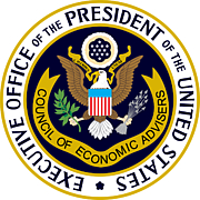 "Fotografia de autor. By Executive office of the President - CEA.gov, EXPO outline from WIkipedia OMB Seal, Public Domain, <a href=""https://commons.wikimedia.org/w/index.php?curid=9105974"" rel=""nofollow"" target=""_top"">https://commons.wikimedia.org/w/index.php?curid=9105974</a>"