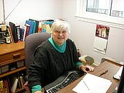 Författarporträtt. Marlene Macke at her desk