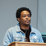 """Kirjailijan kuva. reading at Split This Rock 2018, Washington, D.C. By Slowking4 - Own work, GFDL 1.2, <a href=""""https://commons.wikimedia.org/w/index.php?curid=68432360"""" rel=""""nofollow"""" target=""""_top"""">https://commons.wikimedia.org/w/index.php?curid=68432360</a>"""