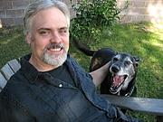 Författarporträtt. John Brantingham with Archie.