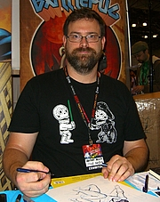 """Författarporträtt. Comics creator Mike Norton during an October 16, 2011 appearance at the New York Comic Con in Manhattan. This photo was created by Luigi Novi. By Luigi Novi, CC BY 3.0, <a href=""""//commons.wikimedia.org/w/index.php?curid=17292064"""" rel=""""nofollow"""" target=""""_top"""">https://commons.wikimedia.org/w/index.php?curid=17292064</a>"""