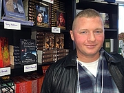 Forfatter foto. Me at a the Mysterious Galaxy holiday party, here in beautiful San Diego, posing in front of my books. Because you just gotta do that, right? :)