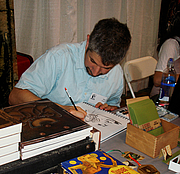 Author photo. Sketching at MoCCA Art Festival 2009, photo by Lampbane