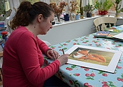 Fotografia dell'autore. Tina Macnaughton signing a limited edition print from one of here books. December 2018