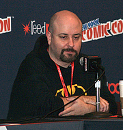"Author photo. Comic book writer and novelist Marc Andreyko speaking on a panel regarding The Illegitimates, the IDW comic book miniseries created by him and actor/comedian Taran Killam, on Sunday, October 13, 2013 at the Jacob K. Javits Convention Center in Manhattan, Day 4 of the 2013 New York Comic Con. This photo was created by Luigi Novi By Luigi Novi, CC BY 3.0, <a href=""//commons.wikimedia.org/w/index.php?curid=30062643"" rel=""nofollow"" target=""_top"">https://commons.wikimedia.org/w/index.php?curid=30062643</a>"