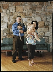 """Author photo. Robin Wells and husband Paul Krugman, with their cats. Photo by Tina Barney for <a href=""""http://www.newyorker.com/reporting/2010/03/01/100301fa_fact_macfarquhar"""" rel=""""nofollow"""" target=""""_top"""">The New Yorker</a>."""