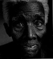 """Fotografia de autor. Cyril Lionel Robert James (1901-1989) 1989 photograph (<a href=""""http://www.marxists.org/archive/james-clr/index.htm"""">CLR James Internet Archive</a>)"""