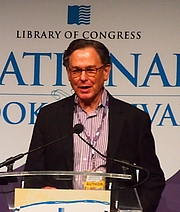 """Author photo. reading at National Book Festival By Slowking4 - Own work, GFDL 1.2, <a href=""""https://commons.wikimedia.org/w/index.php?curid=62180275"""" rel=""""nofollow"""" target=""""_top"""">https://commons.wikimedia.org/w/index.php?curid=62180275</a>"""