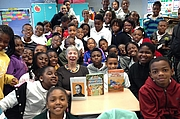 """Författarporträtt. """"Surrounded by the wonderful fourth grade classes at Dr. Martin Luther King Charter School, Ninth Ward, New Orleans"""" via author's website, patricialakin.com"""