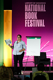 """Författarporträtt. Juana Medina gives a presentation on the Children's Purple Stage at the National Book Festival, August 31, 2019. Photo by Edmond Joe/For the Library of Congress. By Library of Congress Life - 20190831EJ0284.jpg, CC0, <a href=""""https://commons.wikimedia.org/w/index.php?curid=82899172"""" rel=""""nofollow"""" target=""""_top"""">https://commons.wikimedia.org/w/index.php?curid=82899172</a>"""