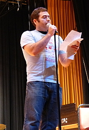 Author photo. This photo is of Brian Jaeger reading at the annual Thassophobia Read-In he organized at Menomonee Falls High School near Milwaukee, Wisconsin.