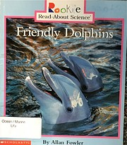 Friendly dolphins av Allan Fowler